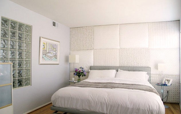 Fabric panels behind the bed
